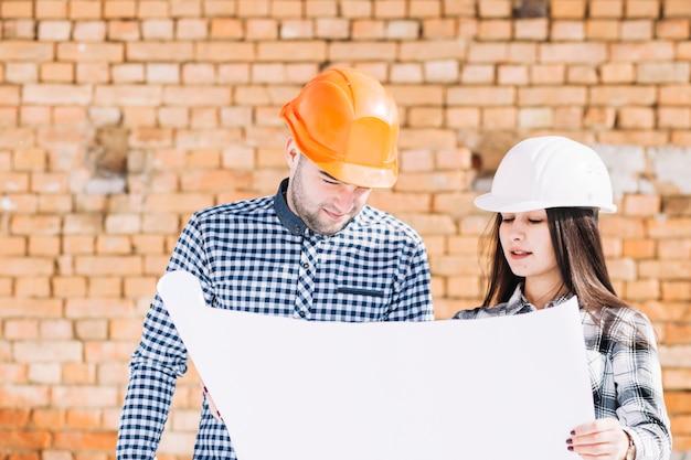 Arquitetos, frente, parede tijolo