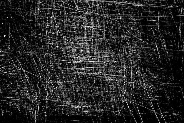 Arranhões brancos em um fundo preto. vidro riscado caótico. foto de alta qualidade