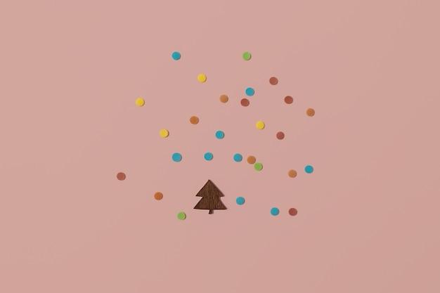 Arranjo de natal moderno feito com árvore de natal de madeira, enfeite de coração vermelho, granulado e galho de árvore perene sobre fundo rosa claro brilhante. conceito mínimo de natal com espaço de cópia.