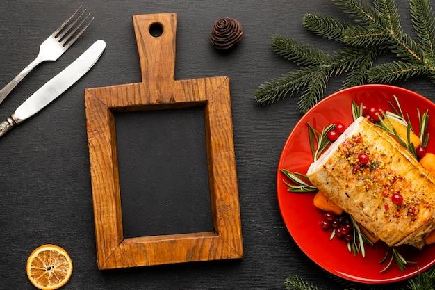 Arranjo de prato festivo de natal com quadro-negro