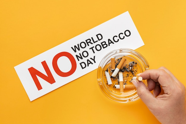 Arranjo plano de elementos do dia sem tabaco