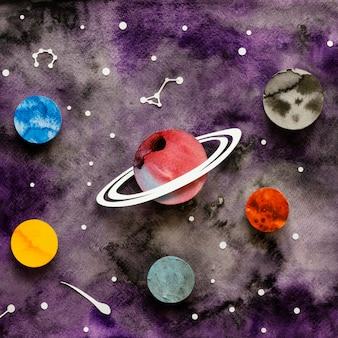 Arranjo plano de planetas de papel criativos