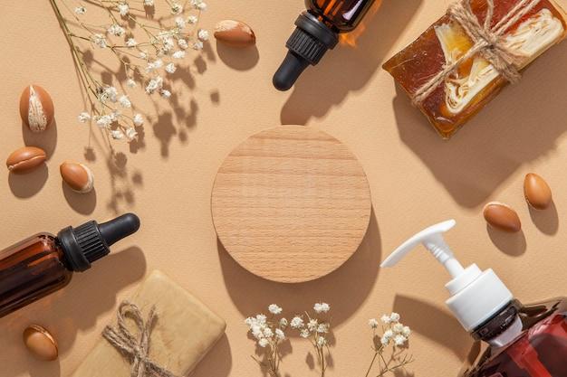 Arranjo plano de produto de cuidado de óleo de argan