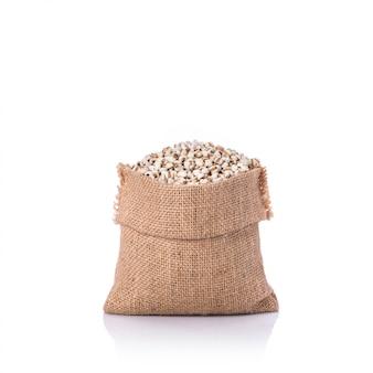 Arroz painço ou grãos de milho em saco pequeno.