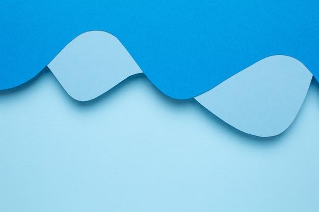 Arte abstrata com corte de papel azul