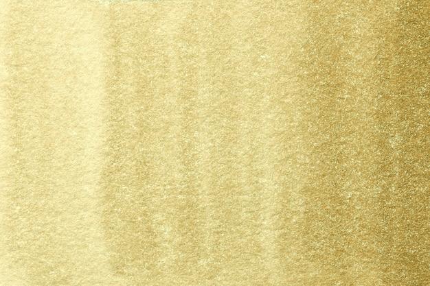 Arte abstrata cores claras e douradas.