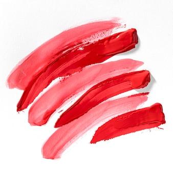 Arte abstrata de manchas de tinta vermelha e rosa
