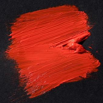 Arte abstrata de traçado de pincel vermelho