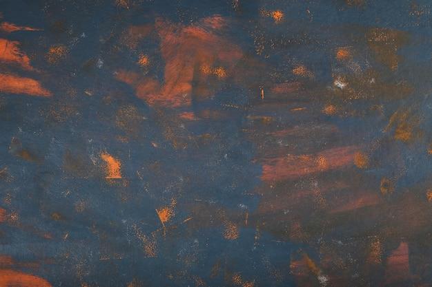 Arte abstrata em mármore com tinta azul e laranja.