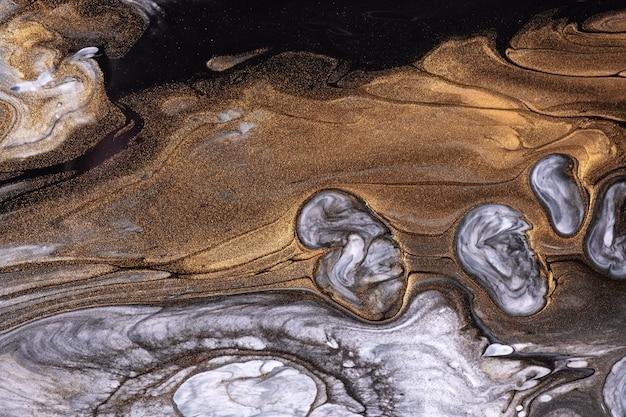 Arte abstrata fluida de fundo preto e dourado