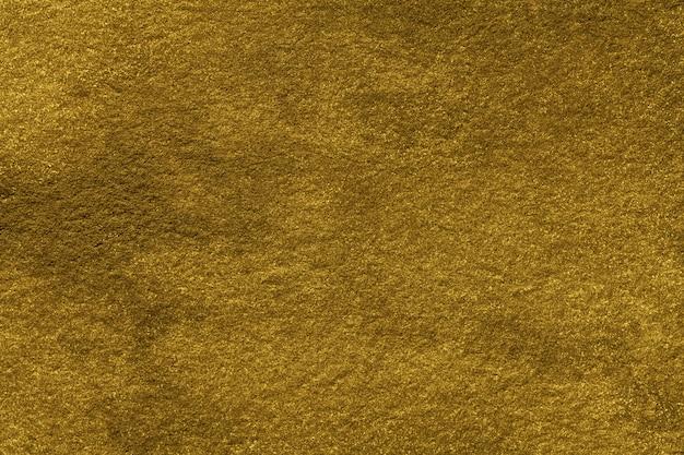 Arte abstrata fundo cor dourada. pintura em aquarela sobre tela com gradiente. textura de papel amarelo velho.