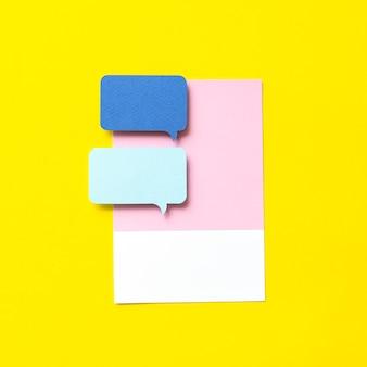 Arte de artesanato de papel do ícone de bolha do discurso