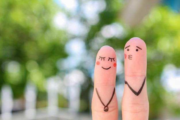 Arte de dedos de casal feliz. conceito de homem sopra beijo, mulher fica com vergonha.