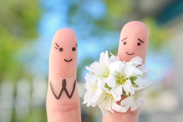 Arte de dedos de casal feliz. o homem está dando flores para a mulher.