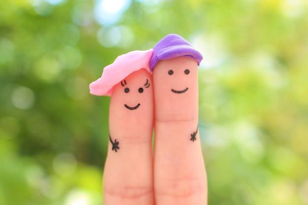 Arte de dedos do casal feliz de férias.