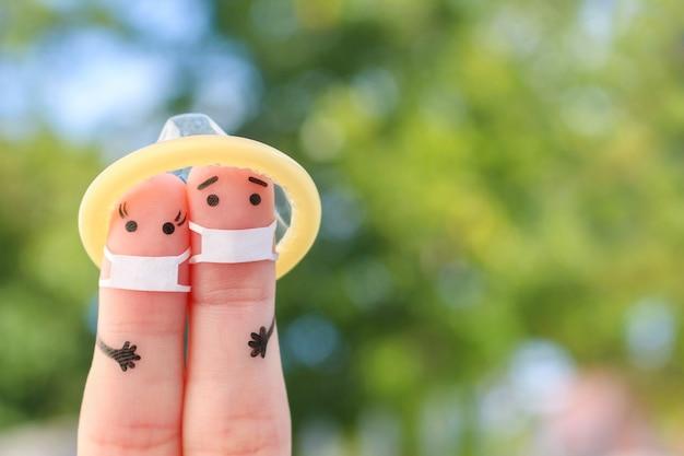 Arte de dedos do casal feliz na máscara médica de covid-2019. conceito de sexo seguro.