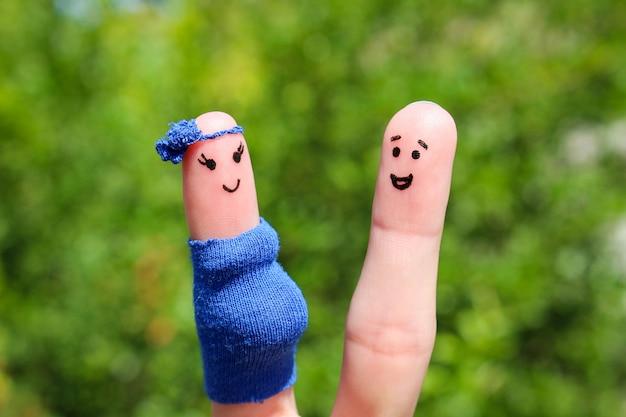 Arte do dedo de um casal feliz. mulher está grávida.