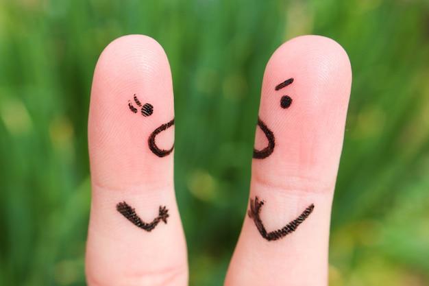 Arte do dedo de um par durante a discussão.