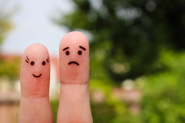 Arte do dedo do casal. a mulher é alegre, o homem está triste.