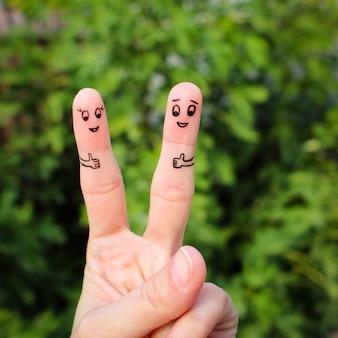Arte do dedo do casal feliz, mostrando os polegares