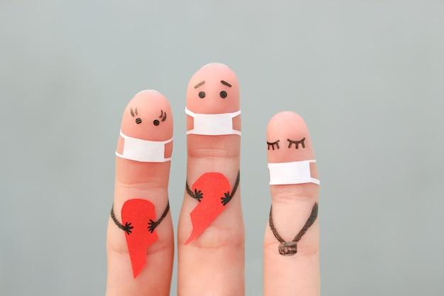 Arte dos dedos da família na máscara médica do covid-2019. conceito de casal segurando um coração partido.