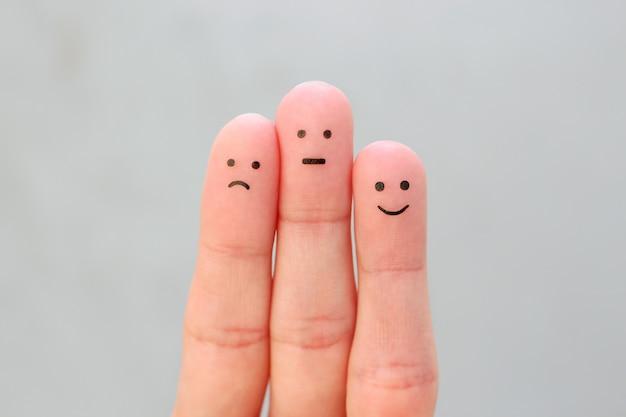 Arte dos dedos das pessoas. conceito de emoções positivas e negativas.