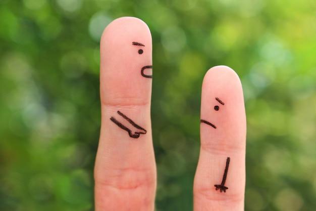 Arte dos dedos das pessoas. conceito de homem repreendendo a criança.