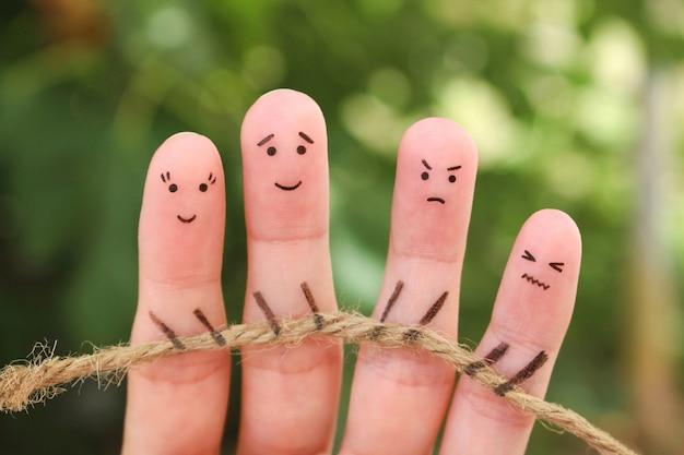 Arte dos dedos das pessoas. eles estão jogando cabo de guerra com corda.