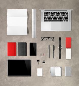Artigos de papelaria de marca de mesa de escritório de concreto. vista do topo