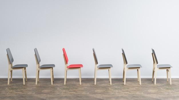 As cadeiras estão localizadas em uma sala vazia na parede cinza
