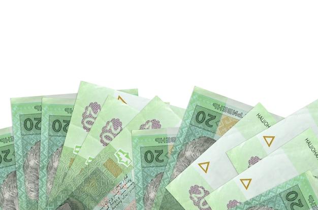 As contas de hryvnias ucranianas encontram-se na parte inferior da tela, isoladas em branco