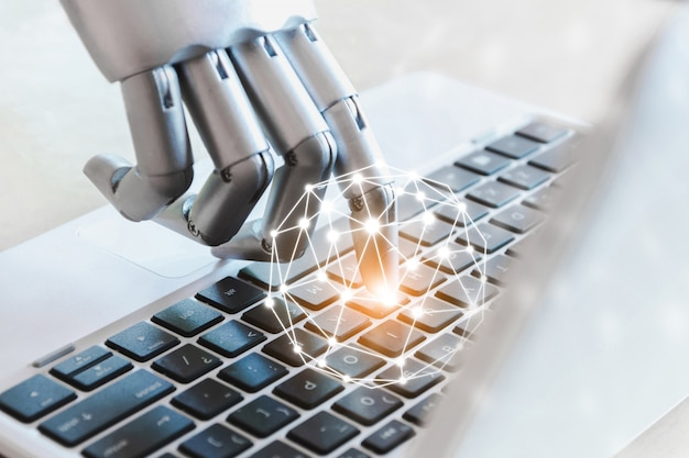 As mãos e os dedos do robô apontam para o conceito de inteligência artificial robótica de consultor de botão de laptop de tecnologia