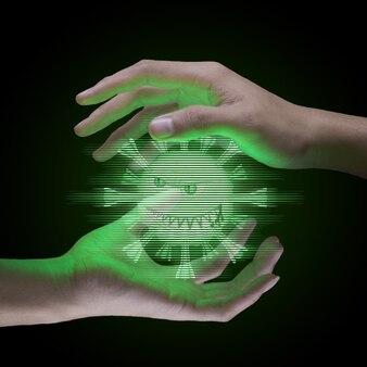 As mãos equipam segurando o holograma verde de um modelo de vírus, o vírus está entre as duas mãos em fundo preto, célula de vírus com rosto assustador e maligno, vírus ou coronavírus ou conceito covid-19.