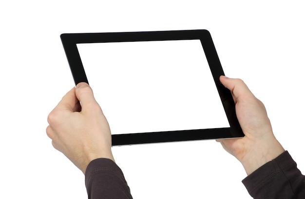 As mãos estão segurando o dispositivo com tela de toque Foto Premium