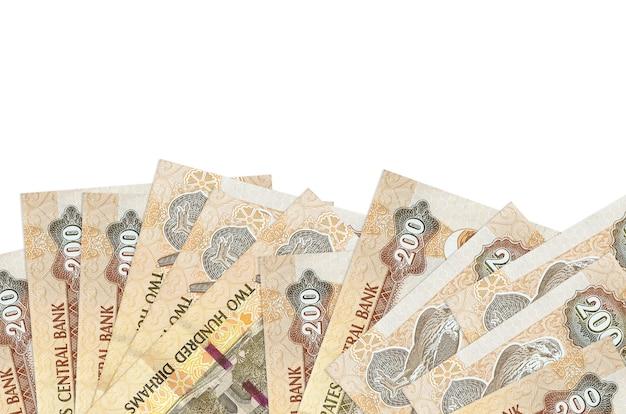 As notas de dirhams dos emirados árabes unidos estão na parte inferior da tela, isoladas