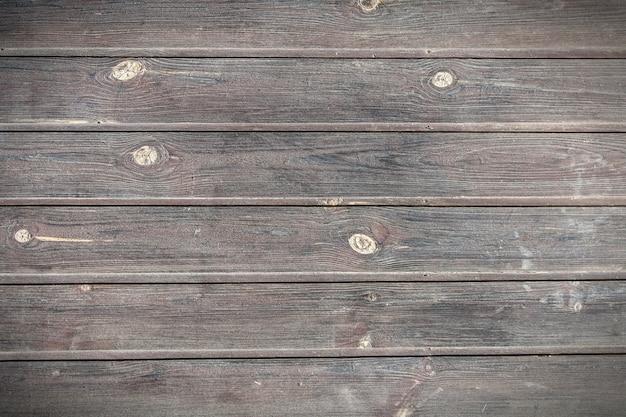 As placas de madeira de textura velha.
