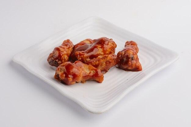 Asas de frango frito picante quente