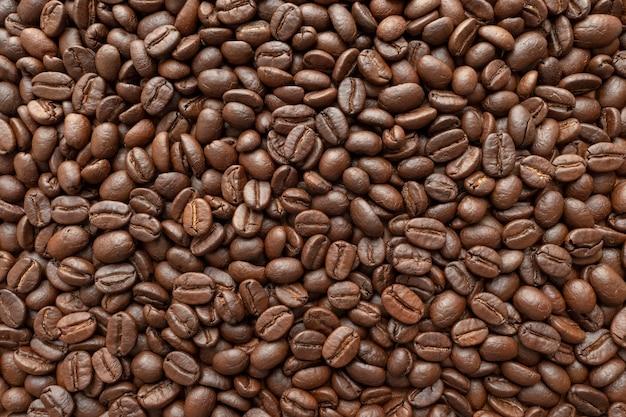 Assado de grãos de café para o fundo. fechar-se.