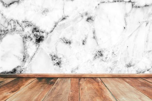 Assoalho de madeira com textura de mármore branca da parede para indicar seu fundo dos produtos