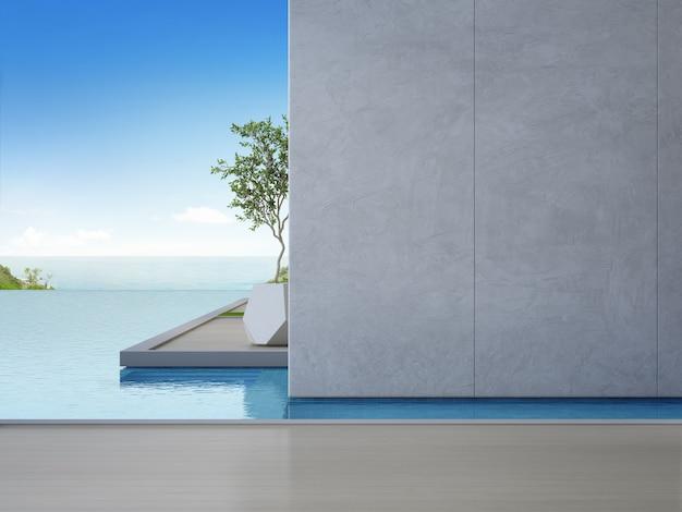 Assoalho de madeira vazio com muro de concreto em casa de praia de luxo.