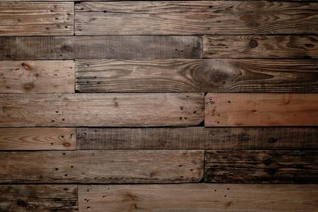 Assoalho de prancha de madeira polida escura velha e vintage