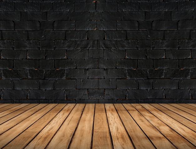 Assoalho vazio da prancha de madeira e parede de tijolo preta, fundo interior da sala