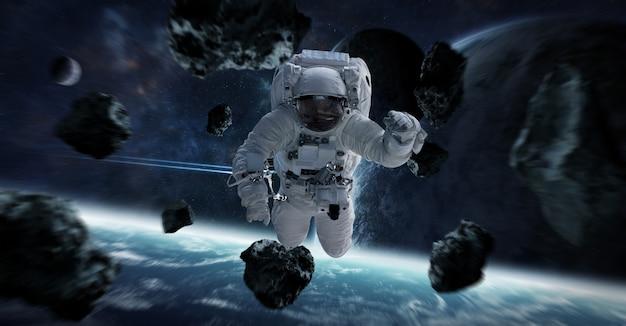 Astronauta flutuando em elementos do espaço desta imagem fornecida pela nasa