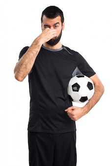 Atleta de futebol cheira retrato preto