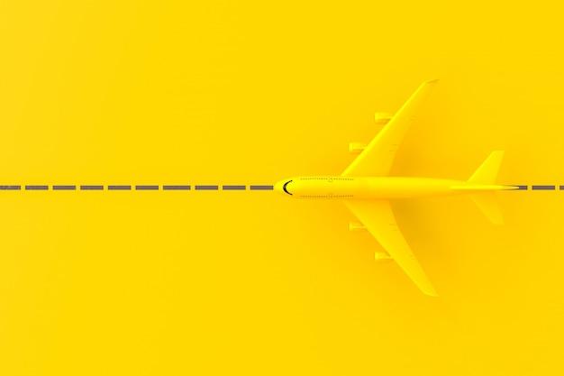 Avião amarelo na pista.