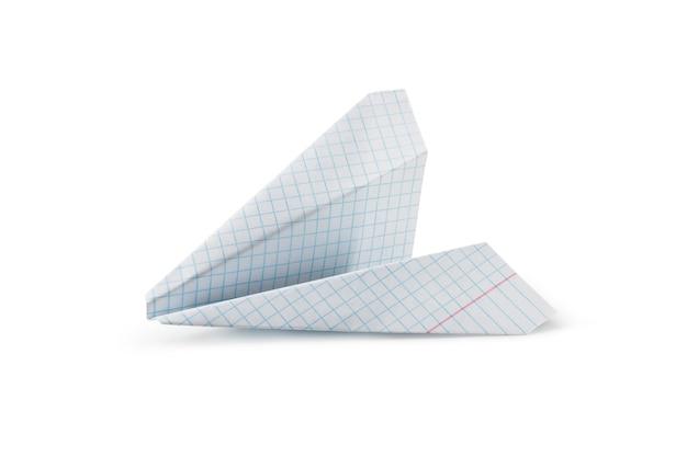 Avião de papel infantil da folha do caderno de matemática