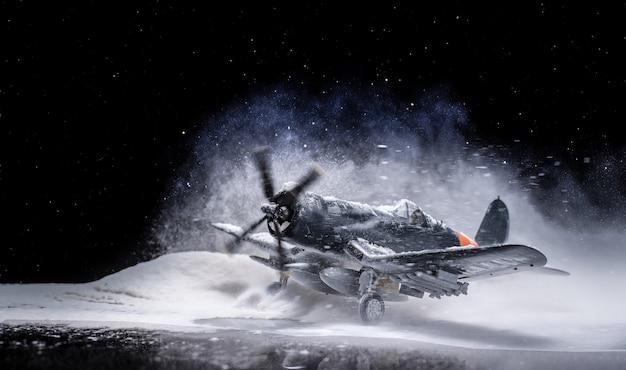 Avião militar da segunda guerra mundial com forte queda de neve