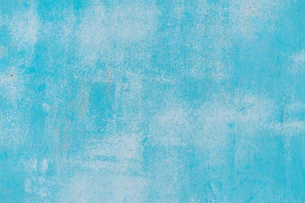 Azul e branco velho padrão de pintura rachada na parede