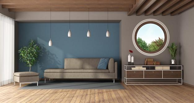 Azul e moderna moderna sala de estar com janela redonda