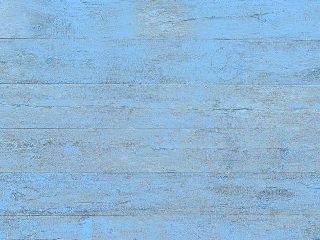 Azul pintado no fundo da mesa de madeira.
